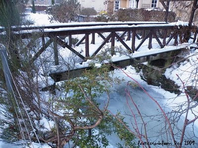 A bridge over Perth Lade to someone's garden
