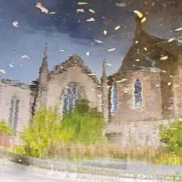 reflection of Kinnoull Church with autumn leaves floating on the surface of the water seen on Scott Kelby's Photowalk